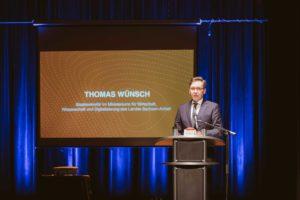 Thomas Wünsch, Staatssekretär im Ministerium für Wirtschaft, Wissenschaft und Digitalisierung des Landes Sachsen-Anhalt hält eine Rede